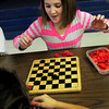 Salisbury: Sheridyn LaRocque, 10, reacts as gets ready to beat her friend Aneesa Baez, 9, at a game of checkers Wednesday afternoon. The two were part of a tournament at the Boys and Girls Club. Bryan Eaton/Staff Photo