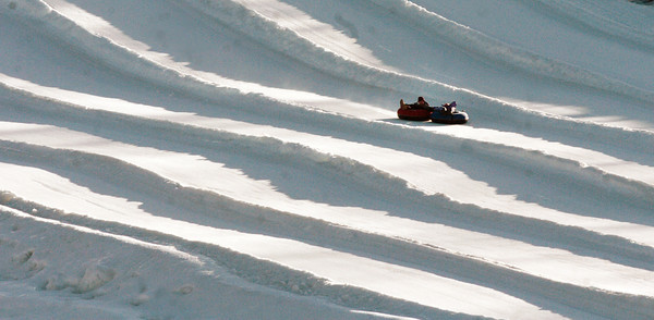 Amesbury: Yesterday's windy weather didn't deter some school groups from tubing down the hill at the Amesbury Sports Park. Bryan Eaton/Staff Photo