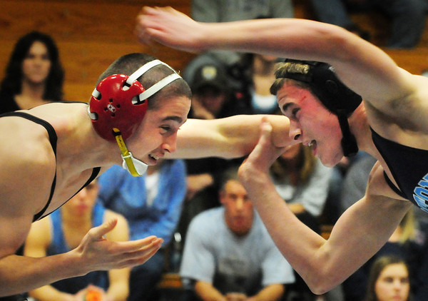 Byfield: North Andover's Brad Drover, left, and Triton's Mark Boyle battle it out on the mat last night in Byfield with Drover winning in the 145 pound class. Bryan Eaton/Staff Photo