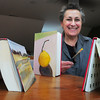 Salisbury: Salisbury Library Trustee and painter who is recycling old books by making them her canvas and creating works of art. Books are being sold for $100, as a fundraiser for the Salisbury Library Building fund. Bryan Eaton/Staff Photo