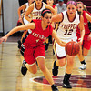 Newburyport: Amesbury's Janine Fatal breaks away from Newburyport's Molly Rowe. Bryan Eaton/Staff Photo