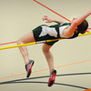 Ipswich: Pentucket's Charlotte Merritt goes over the pole in the high jump in a match with Ipswich. Bryan Eaton/Staff Photo
