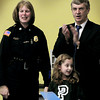 West Newbury: Page School principal Jack O'Mara applauds as second-grader Reagan Goldstein, 7, received a certificate from West Newbury Police Lisa Holmes on Friday. Reagan was quick to call 911 and opened the door for EMT's as they arrived when her mother was in respiratory arrest recently. Bryan Eaton/Staff Photo
