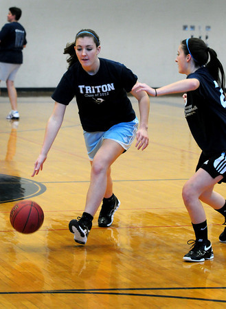 Byfield: Hannah Canning, right, gives coverage to her sister Jessica during basketball practice yesterday. Bryan Eaton/Staff Photo