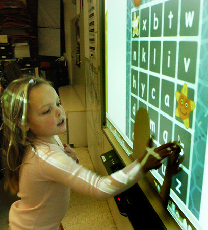 Amesbury: Greta Becker, 6, hits squares while playing the web-based Alphabet Bingo in Bruce McBrien's technology class at Amesbury Elementary School on Wednesday. The game helps students with letter recognition in upper and lower class forms. Bryan Eaton/Staff Photo
