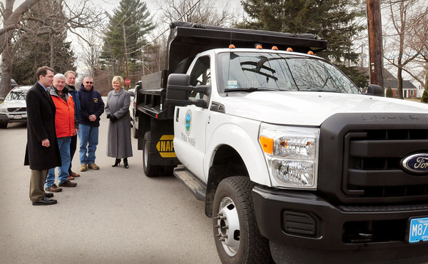 Byfield: The Governor's Academy in Byfield donated money for the Newbury Department of Public Works for a new truck. Checking out the vehicle, from left, Headmaster Peter Quimby, selectman Joe Story, Governor's Academy CFO Hugh McGraw, DPW head Tim Leonard and Newbury town administrator Tracy Blais. Bryan Eaton/Staff Photo