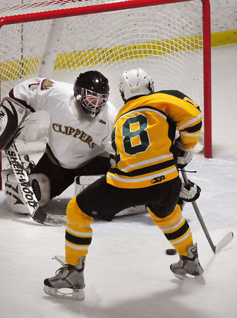 Newburyport: Newburyport goalie Daniel Murphy braces for a shot by North Reading player Cameron Knight that went wide. Bryan Eaton/Staff Photo
