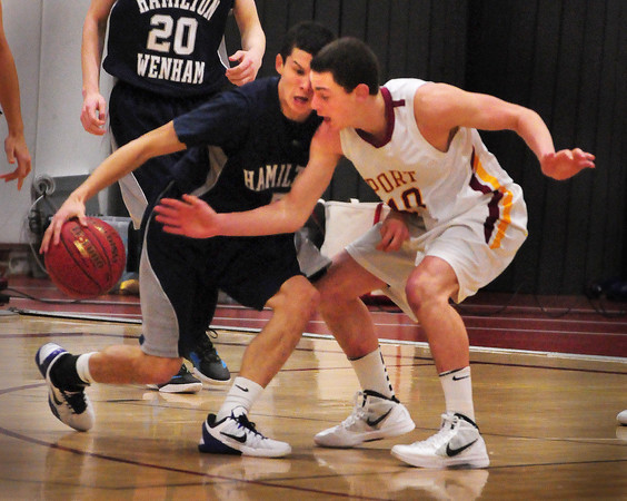 Newburyport: Newburyport's Ian Michaels, right, puts pressure on Hamilton-Wenham's Stephen Tam last night. Bryan Eaton/Staff Photo