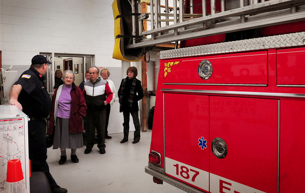 "Merrimac: Lt. Tim Carey of the Merrimac Fire Departments gives a tour to members of the Merrimac Senior Center before getting a tour of the police department on Thursday morning. They were treated to the tours after their ""Breakfast With the Chiefs."" Bryan Eaton/Staff Photo"