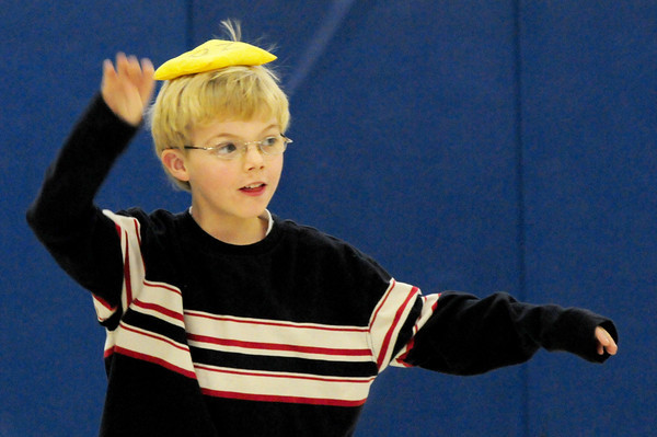 Amesbury: Dillon Metcalf, 6, balances a bean bag on his head walking along the gymnasium at Amesbury Elementary School on Wednesday afternoon. The children were learning different muscle skills including balance. Bryan Eaton/Staff Photo