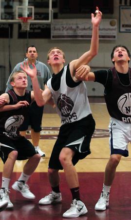 Newburyport: Newburyport High basketball player Alex Losch, center, goes for rebounds with teammates during practice last night. Bryan Eaton/Staff Photo