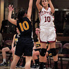 Newburyport: Newburyport star player Beth Castantini goes for two points against Lynnfield. Bryan Eaton/Staff Photo