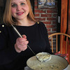 Newburyport: Kimmy Bingham dishes up her Beer and Baked Potato Soup. Bryan Eaton/Staff Photo