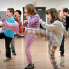 Salisbury: Children work through karate basics at the beginning of a six-week course in Explorations, an afterschool program at Salisbury Elementary School on Wednesday. The course is being taught by the school's speech therapist, Colleen Poulin, who teaches karate at Tokyo Joe's Studio in Salisbury. Bryan Eaton/Staff Photo