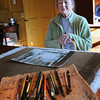 Merrimac: Merrimac artist Mabelle Robbie does her painting at her dining room table. Bryan Eaton/Staff Photo