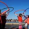 Newburyport: Kindergartners from the Newburyport Montessori School excercise with hula hoops yesterday afternoon on the Newburyport Waterfront along the boardwalk in gym class. Bryan Eaton/Staff Photo