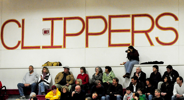 Newburyport: Kim Adsit get a bird's eye view as she sits above the crowd at the Newburyport High girls basketball game which was hosting Amesbury last night to take photos. Her daughter, Meriwether plays for the Clippers. Bryan Eaton/Staff Phot