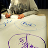Amesbury: Zachary Rome, 7, signs his name to one of several posters in the cafeteria at Amesbury Elementary School at lunch on Wednesday morning. Governor Patrick designated the day to be No Name Calling Day in all schools across Massachusetts and children at the school took the pledge by signing the posters. Bryan Eaton/Staff Photo