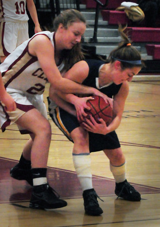 Newburyport: Newburyport's Lilly Donovan grapples for the ball with a Lynnfield player last night. Bryan Eaton/Staff Photo