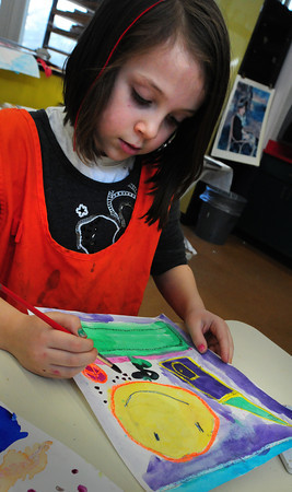 Amesbury: Hayden Talbot, 6, works on a painting using geometric shapes before creating a new one that will incorporate organic images of nature. Her class was learning different art techniques in Linda Greenfield's art class at the Cashman School in Amesbury on Tuesday. Bryan Eaton/Staff Photo
