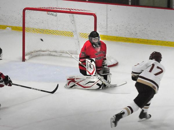 Newburyport: Newburyport's Cooper Hines goes wide against North Andover goalie Joel Daccord. Bryan Eaton/Staff Photo