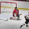 Newburyport: Newburyport's Cooper Hines goes wide against North Andover goalie Joel Daccord. Bryan Eaton/Staff Photo