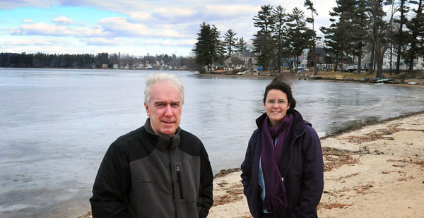 Merrimac: Lake Attitash Association's Cindy Roberts, right,  and her group have been raising $90,000 to treat the lake for invasive plant species and blue-green algae. Amesbury Municipal councilor Joe McMilleon, left, is sponsoring a bill to help with that goal. Bryan Eaton/Staff Photo