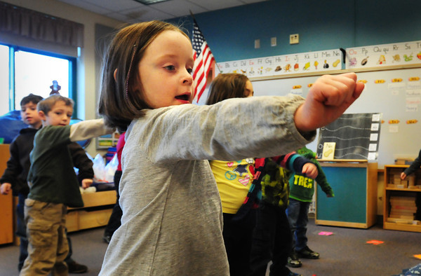 "Newbury: ""D"" and daa yells out Makenzie Foley in Carol Jakobson's kindergarten class on Wednesday morning. The children were ""letter sizing"" by singing the words of the alphabet to music while also excercising body and mind yelling the letter then, the phonic sound of it. Bryan Eaton/Staff Photo"