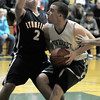 West Newbury: Pentucket's Nolan Dragon makes a move under the basket on Lynnfield's Nicola Varano during their game Friday night at Pentucket. Jim Vaiknoras/staff photo