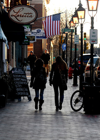Newbuyport: The cold weather this weekend kept all but the hardiest, like these folks on State Street in Newburyport, warm indorrs this weekend. Jim Vaiknoras/staff photo