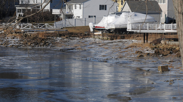 Amesbury: Ice formed along the banks of the Merrimack River near Main Street in Amesbury. Jim Vaiknoras/staff photo