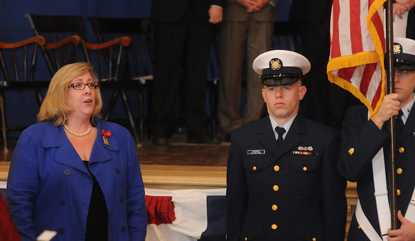 Newburyport: Ann Ormond, president of the Greater Newburyport Chamber of Commerce & Industry, sings the national anthem during Newburyport's inauguration ceremony at City Hall Monday. Jim Vaiknoras/staff photo