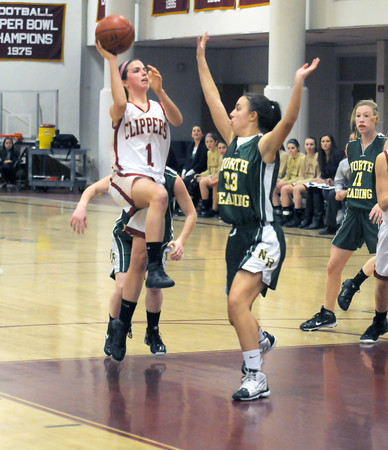 Newburyport: Newburyport's Aly Leahy with a runner in the lane  during the Clippers game against North Reading Friday night at Newburyport high. JIm Vaiknoras/staff photo