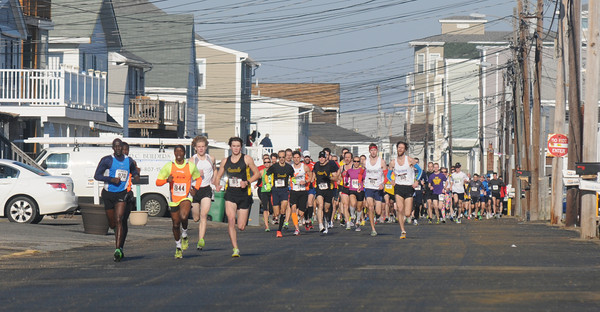 Salisbury: Runners head down Atlantic Ave in Salisbury at the start of  the Hang Over Classic Road Race. Jim Vaiknoras/staff photo