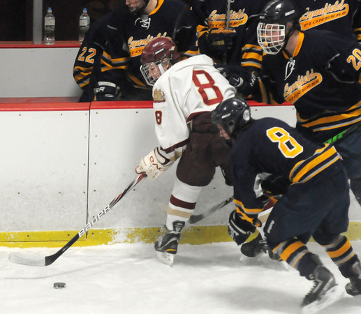 Newburyport: Newburyport's Tyler Cusack clears the puck off the boards during the Clipper's game against Lynnfield Saturday at the Graff Rink in Newburyport. Jim Vaiknoras/staff photo