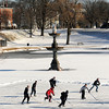 Newburyport: A group of hockey players enjoy the frozen Frog Pond at the Bartlett Mall Friday morning. The Mall was to be the site of next Sunday Winter Carnival, the event was canceled. Jim Vaiknoras/staff photo