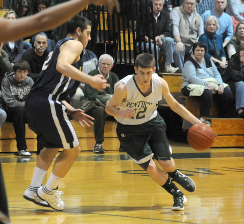 West Newbury: Pentucket's Cory McNamara drives to the basket on Lynnfield's Carmine Dicesare during their game Friday night at Pentucket. Jim Vaiknoras/staff photo