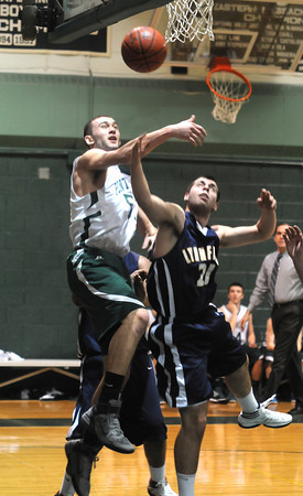 West Newbury: Pentucket's Will Angelini blocks a shot by Lynnfield's Stephen Carangelo during their game Friday night at Pentucket. Jim Vaiknoras/staff photo