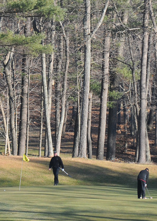 Rowley: Joe Zeuli and Dave MacGilvray take advantage of the warm winter weather to play a round of golf at Carriage Pines Golf Club in Rowley Sunday afternoon.The hardest part of playing in winter, the agreed, is getting the tees in the ground. JIm Vaiknoras/staff photo