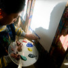 Newburyport: Robbie Thurston, a second grader at the Bresnahan Schoolk in Newburyport, cast a shadow on his eisle as he finger paints in art class Thursday. JIm Vaiknoras/staff photo