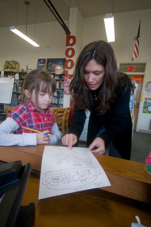 Newburyport: Librarian Michelle Soule helps Jess Rosenthal,7, with a letter she is writting in the Library at the resnahan School in Newburyport Thursday. Jess is a student is Susan Westgate's 2nd grade class. Jim Vaiknoras/staff photo