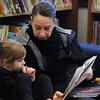 "Amesbury: Lisa Taylor reads "" Amanda Pig and the Wiggly Tooth"" to her daughter Hayden, 3, while they were visiting the Childrens Room at teh Amesbury Library Thursday. Jim Vaiknoras/staff photo"