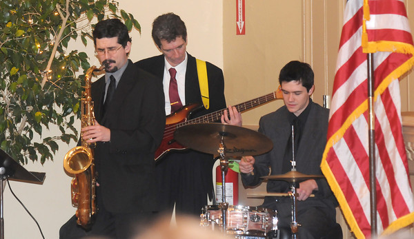 Newburyport: Family members of Mayor Donna Holaday — husband Joe on bass and sons Jared on saxophone and PJ on drums — perform at the Newburyport inauguration Monday in City Hall auditorium. Jim Vaiknoras/staff photo
