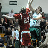 West Newbury: Pentucket's Calvin Wiles puts up a shot over Masconomet's Zach Turcotte. JIm Vaiknoras/staff photo