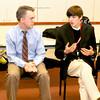 Newburyport: Newburyport High School student Alex Bradley talks with teacher Matt LaChapelle about an exchange with Republican presidential candidate Rick Santorum, while on a field trip to New Hampshire. Jim Vaiknoras/staff photo