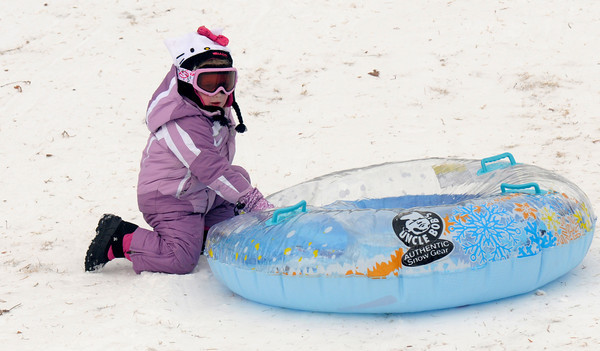 Newburyport: Amelia McCloud, 4, gathers up her tube before heading back up the March's Hill in Newburyport Sunday. JIm Vaiknoras/staff photo