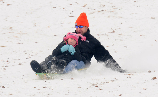 Newburyport: Leah Smullin, 4,of Rowley, gets some snow in her face as she sleds with her dad Sam at the March's Hill in Newburyport Sunday. JIm Vaiknoras/staff photo