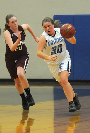 Byfield: Triton's Rachel Williamson is chased by Rockport's Sarah Rowen as she sprints up court after making a steal during their game at Triton Friday night. Jim Vaiknoras/staff photo