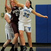 Byfield: Triton's Rachel Williamson makes a steal on Rockport's Sarah Rowen  during their game at Triton Friday night. Jim Vaiknoras/staff photo