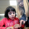 Amesbury: Piper Poulin, a student in Sue Holt's first grade class at Amesbury Elementary school,gets some help from 4th grader Sophia Fortier decorating a hand made wooden heart. The heart along with hundred of others will be send to wounded soilders at Walter Reed Hospital, jim vaiknoras/Staff photo